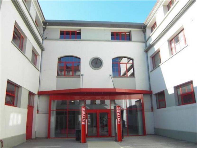 photo de l'entrée de nos locaux de Grenoble